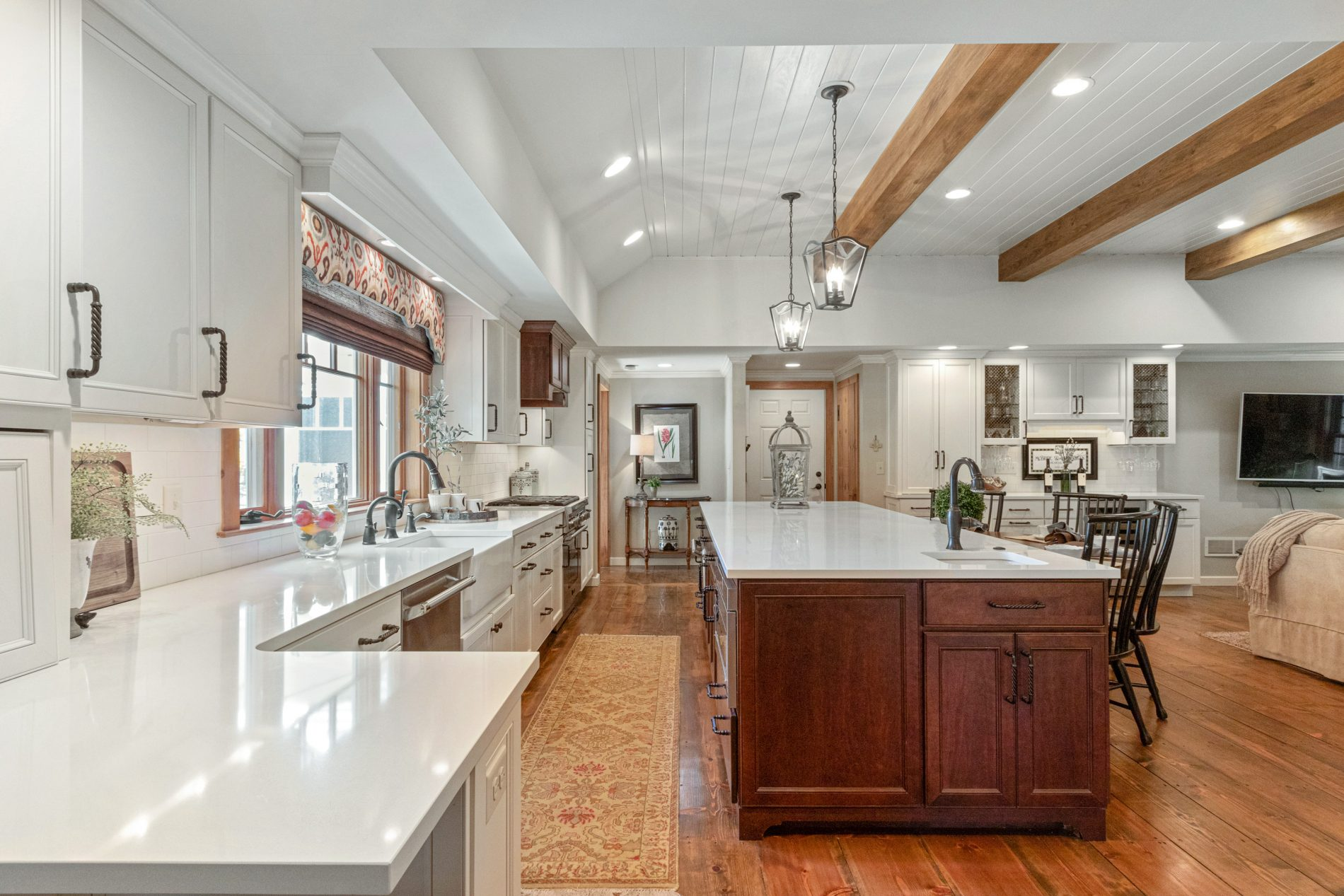 farmhouse style kitchen with white cupboards